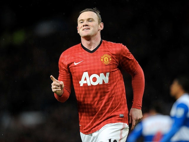 United's Wayne Rooney celebrates a goal against Reading on March 16, 2013
