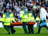 Newcastle United's Massadio Haidara is carried from the field on a stretcher after picking up an injury during his side's match against Wigan on March 17, 2013