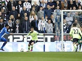 Wigan Athletic's Jean Beausejour scores against Newcastle United on March 17, 2013