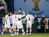 Denmark's players celebrate after a goal during their World Cup qualifiying match against the Czech Republic on March 22, 2013