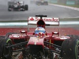 Ferrari driver Fernando Alonso crashes and ends up on the gravel during the Malaysian Grand Prix on March 24, 2013