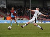 Doncaster's Iain Hume scores his team's second against Scunthorpe on March 23, 2013
