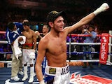Jamie McDonnell celebrates his win against Darwin Zamora on October 20, 2012