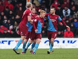 Scunthorpe's Mark Duffy celebrates with team mates after scoring against Doncaster on March 23, 2013