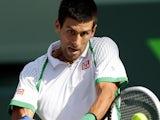 Novak Djokovic returns the ball during the match against Somdev Devvarman on March 24, 2013