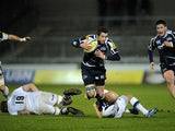 Sale Sharks' Nick Macleod is tackled by Bath's Peter Stringer during the Aviva Premiership on March 22, 2013