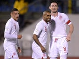 England's Jermaine Defoe celebrates scoring against San Marino during the World Cup qualifier on March 22, 2013