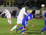 England's Wayne Rooney scores a freekick during his side's World Cup qualifier against San Marino on March 22, 2013
