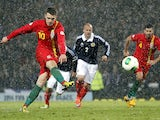 Wales player Aaron Ramsey scores from the penalty spot during his side's World Cup qualifier with Scotland on March 22, 2013