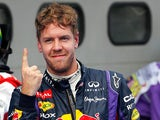 Red Bull driver Sebastian Vettel celebrates after taking pole position during qualifying of the Malaysian Grand Prix on March 23, 2013