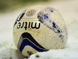 A football in the snow taken January 18, 2013