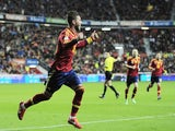 Spain's Sergio Ramos celebrates scoring against Finland during the World cup qualifying match on March 22, 2013