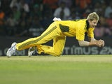 Australia's Steve Smith dives for a catch to dismiss Sri Lankan batsman Dinesh Chandimal on August 8, 2011
