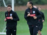 England players Steven Gerrard and Rio Ferdinand during a training session on October 8, 2010