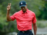 Tiger Woods waves to the crowd on the final day at the Arnold Palmer Invitational on March 24, 2013