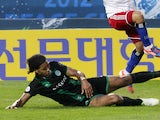 FC Groningen player Virgil van Dijk makes a tackle during his side's match with Hamburger SV on July 20, 2012