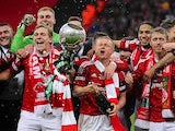 Wrexham players celebrates after beating Grimsby in the FA Carlsberg Trophy Final on March 24, 2013