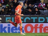 Millwall's Alan Dunne celebrates after scoring the winner against Leicester on March 29, 2013