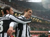 Juventus' Alessandro Matri is mobbed by team mates after scoring his team's second against Inter on March 30, 2013