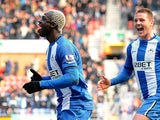 Arouna Kone is joined by James McCarthy after scoring the winning goal against Norwich on March 30, 2013