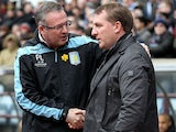 Aston Villa manager Paul Lambert and Liverpool manager Brendan Rodgers greet each other before kick off on March 31, 2013