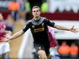 Liverpool's Jordan Henderson celebrates scoring against Aston Villa on March 31, 2013