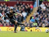 Liverpool captain Steven Gerrard scores from the penalty spot during his side's match with Aston Villa on March 31, 2013