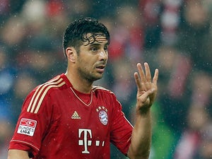 Munich's Claudio Pizarro gestures during the match against Hamburger on March 30, 2013