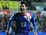 Croatia's Eduardo celebrates scoring against Wales on March 26, 2013