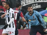 Bologna's Cianluca Curci celebrates after saving Udinese forward Antonio Di Natale's penalty on March 30, 2013