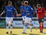 Peterborough United's Grant McCann celebrated with team mate Lee Tomlin after scoring a penalty against Cardiff on March 30, 2013