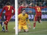 France 'keeper Hugo Lloris sits dejected after Pedro's goal for Spain on March 26, 2013