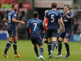 Jan Vertonghen is congratulated by team mates after scoring the opening goal against Swansea on March 30, 2013