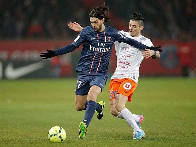 PSG's Javier Pastore and Montpellier's Remy Cabella battle for the ball on March 29, 2013
