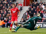 Jay Rodriguez slots the ball past Petr Cech to score the opening goal against Chelsea on March 30, 2013