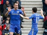 John Terry is congratulated by team mate Oscar after scoring the equaliser against Southampton on March 30, 2013