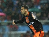Valencia's Jonas celebrates a goal against Atletico Madrid on March 31, 2013