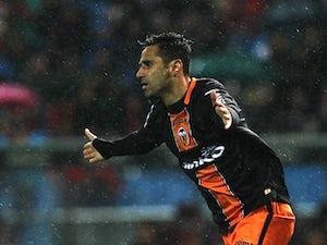 Valencia's Jonas celebrates a goal against Atletico Madrid on March 31, 2013