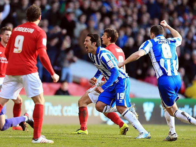 Brighton's Leonardo Ulloa celebrates after scoring the opening goal against Nottingham Forest on March 30, 2013