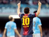 Barcelona's Lionel Messi celebrates after scoring his team's second against Celta Vigo on March 30, 2013
