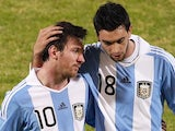 Argentina teammates Lionel Messi and Javier Pastore leave the pitch after beating Costa Rica on July 11, 2011