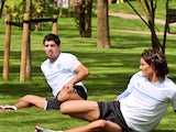 Uruguay players Luis Suarez and Edinson Cavani stretch inside the Olympic athletes village on July 30, 2012