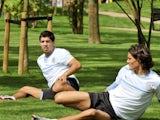 Uruguay players Luis Suarez and Edinson Cavani stretch inside the Olympic athletes village on July 30, 2012