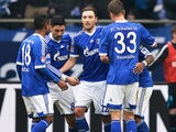 Schalke's Marco Hoeger is congratulated by team mates after scoring the opening goal against Hoffenheim on March 30, 2013