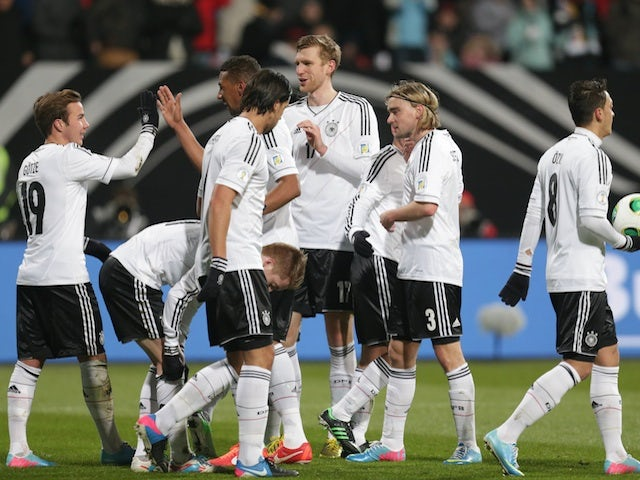 Germany's Mario Goetze celebrates with teammates after a goal against Kazakhstan on March 26, 2013