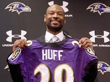 Michael Huff poses with a Ravens jersey during a press conference on March 28, 2013