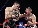 Mike Alvarado lands a punch during his WBO super lightweight title fight with Brandon Rios on March 30, 2013
