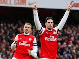 Mikel Arteta celebrates after converting a penalty to score his team's fourth against Reading on March 30, 2013