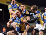Leeds Rhinos' Mitch Achurch is congratulated by team mates after scoring a try against Bradford Bulls on March 28, 2013