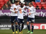 Bolton's Mohamed Kamara celebrates with team mates after scoring his team's second against Charlton on March 30, 2013